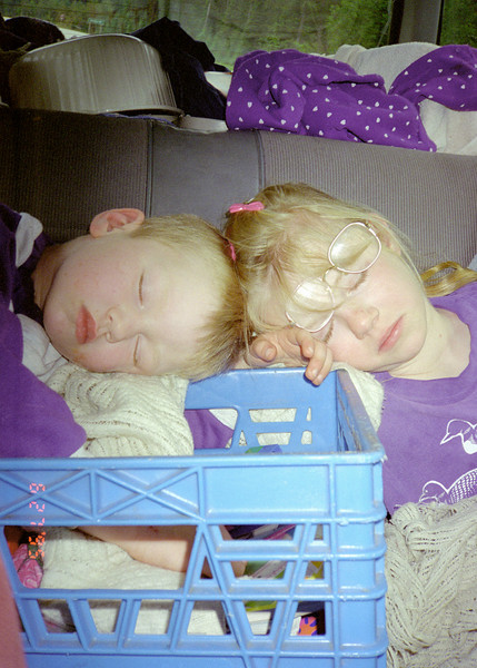 Jacob and Helen sleeping in the car.  Taken during the Drumheller cross Canada trip in 1995.  The image is dated June 27, 1995