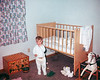 My brother Steve in the midst of his terrible twos.  Helen snapped this shot in Steve's Redwash bedroom. Like all two-year-olds Steve was a handful but I submit he was more terrible than most. One of my mother's favorite horrible Steve stories took place in this very bedroom.  One day my mother ordered Steve to put all his toys in his toybox (seen here). He refused so she said he had to stay in his room until he picked up his toys. Steve had a fit and about thirty minutes into his confinement a neighbor called my mom and said Steve was throwing everything in his bedroom out the window.  When my mother got to his bedroom he was in the process of trying to cram the crib through the window.
