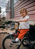 Aileen on her trike in Big Piney Wyoming. We lived in the trailer behind Aileen.  I don't remember much from my Big Piney days. I started Kindergarten there and I, along with some neighborhood kids, spread tar all over somebody's sheets hanging on a clothesline.  I got my ass belted over that stunt. I was a thug; still am!