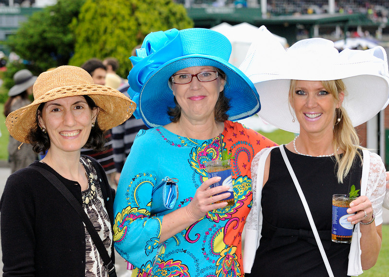 We drove down to Louisville Kentucky and spent the morning walking around a rain soaked Churchill Downs.  Apparently dressing up in gaudy hats is a Kentucky Derby tradition.  Here Mali is posing with two behatted and possibly besotted ladies, (note the mint julep glasses), in the race track infield.