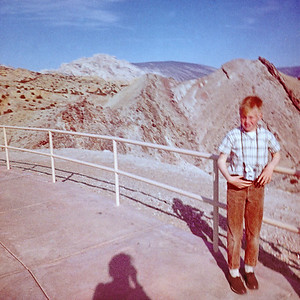 My grandmother Helen took this snapshot of me at Dinosaur National Monument in 1963.  At the time we lived about fifty kilometers from the monument and like most young boys I had a keen interest in dinosaurs. Like today I was touring with a camera. I still nurse a keen interest in dinosaurs and I still run around with cameras. I haven't found any of my old prints or negatives from those days. I was lucky to find this print in Helen's inherited snapshot collection.