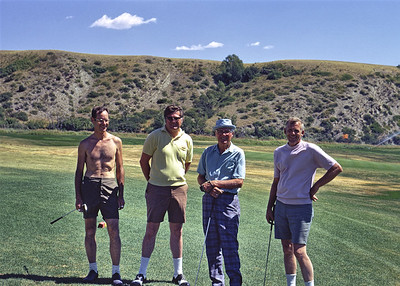In the summer of 1971, I walked around the Livingston Montana golf course with my father, grandfather, and two of their golfing buddies. My grandfather Frank Baker senior is the older man in full-length plaid pants. The man in the yellow shirt beside him is my father, Frank Baker junior. I don't know the other two men.  My dad and grandad were both excellent golfers in their prime. My grandfather even continued golfing after a stroke that made it impossible for him to use both arms. He chased golf balls around the course whacking away with his one good arm while sitting in his golf cart. My father and grandfather are now gone, and I'm next in line. Whenever I look over these old slides, I wish I could give my younger self-framing advice. Never cut off feet in full-body group shots and pay more attention to sun angles to mitigate harsh shadows.