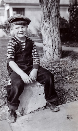 My father Frank as a six year old. He really rocked the Tom Sawyer look.
