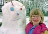 Helen with her snowman.  Glenburnie Ontario.