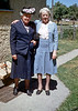 My great grandmother Minnie Raver, (light blue dress), and her sister Maud.   My great grandmother died in the mid seventies at the age of 96.  I only knew her as an old woman.  I don't know when Maud died. <br /> <br /> The colors in this old Kodachrome slide were in excellent condition but the emulsion was covered with many spots and scratches that I tediously removed.