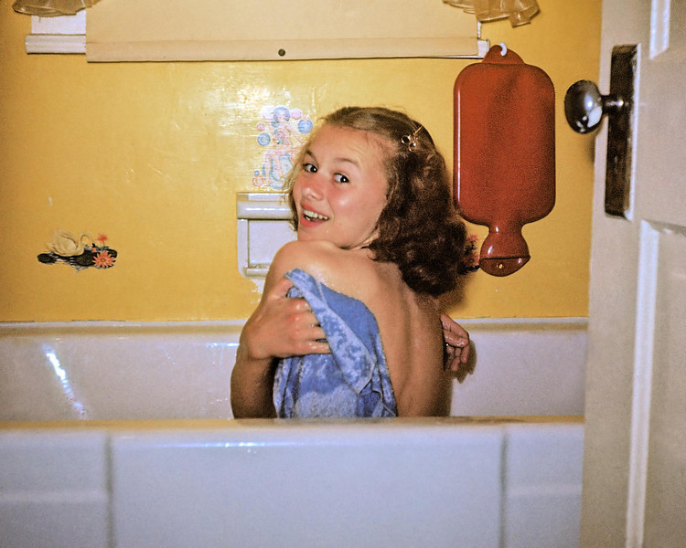 My mother ambushed in the tub by my maternal grandmother.  Taken in 1949 when my mother was fourteen.  The original slide was a dark Kodachrome that I brightened.