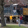 From left, Calvin Corrigan of Framingham, Sean Sauer of Medway, and Stephen Quill-Schuffels of Lancaster, all 17, and train enthusiasts, watch a very long freight train go by Shirley station and take pictures. They identified it as Pan Am Railways' ED-8. (SUN/Julia Malakie)
