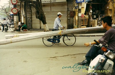 Bicycles have many uses.    Hanoi, Viet Nam