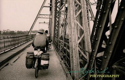 riding bikes on the Long Bien bridge
