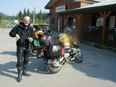 7/18/04 - In front of the Yukon Hotel at Teslin, B. B. Neely poses with his brand new BMW GS, on which he has been enjoying travels around the northland for a few weeks.  (Sorry for the smudge on the lens - I didn't notice it until after I got home and was looking at these photos.)