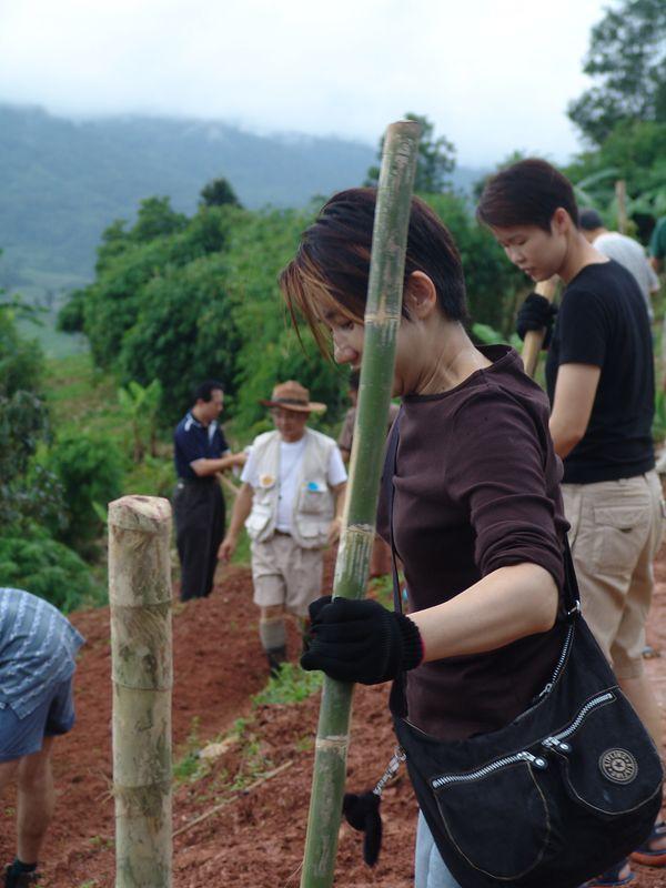 Orapim helping dig the garden in Chiang Rai