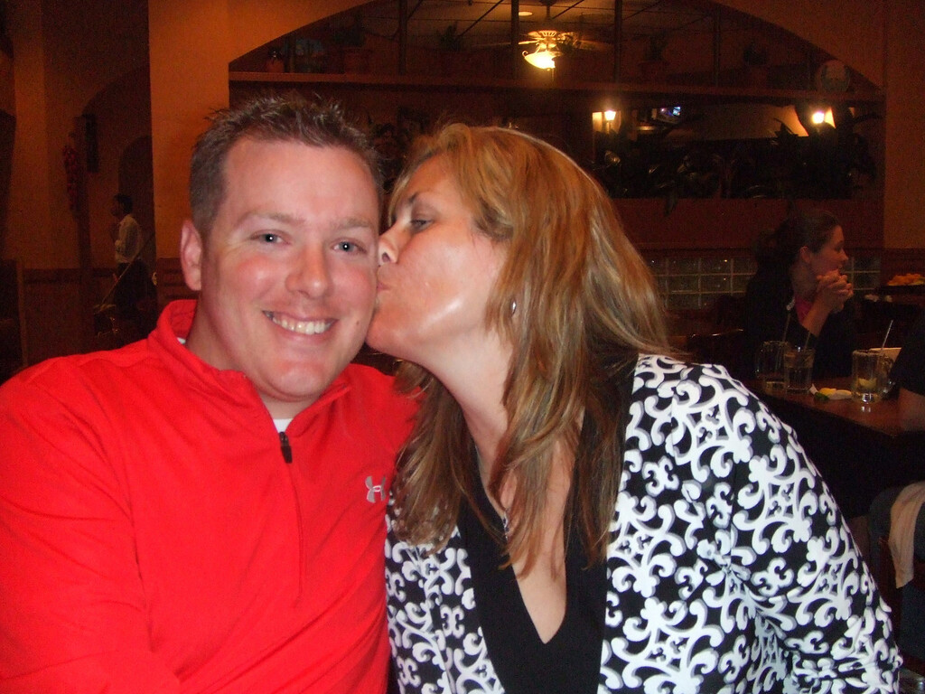 Lynne smooching Kyle at the Mexican restaurant.  27Mar09