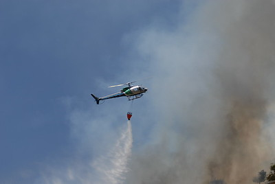 © Joseph Dougherty. All rights reserved.   The East Bay Regional Parks rescue helicopter drops its payload on the fire.