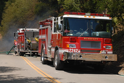 © Joseph Dougherty. All rights reserved.   Berkeley Fire Department trucks parked along Tunnel Road, deployed to keep the fire from jumping the road.