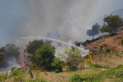 © Joseph Dougherty.  All rights reserved.   From Tunnel Road, the flames could be seen licking up the ridge toward the condos in the Hiller Highlands neighborhood. CDF ground crews fight to get water onto the leading edge of the fire.