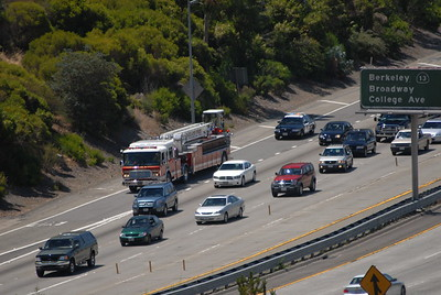 © Joseph Dougherty. All rights reserved.   A ladder truck rushes up Hwy 24, followed by a CHP cruiser, to get to Tunnel Road.