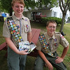 Tyngsboro Eagle Scouts Sam Sigman, 16, left, who sent care packages to the Brother Shitima Orphanage in Malowle, Zambia, that his sister delivered, for his Eagle project, and John Vinal, 17, who made six picnic tables for senior housing. There are three tables at Brinley Terrace; the other three are at Red Pine Terrace senior housing. (SUN/Julia Malakie)