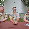 From left, Boy Scout Troop 46 scoutmaster Tom Savage of Tyngsboro, and Tyngsboro Eagle Scouts John Vinal, 17, who made six picnic tables for senior housing for his Eagle Scout project, and Sam Sigman, 16, who sent care packages to the Brother Shitima Orphanage in Malowle, Zambia, that his sister delivered. They are sitting at one of three tables at Brinley Terrace; the other three are at Red Pine Terrace senior housing. (SUN/Julia Malakie)
