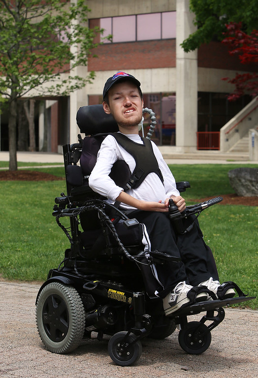 . UMass Lowell graduating senior and math major  Nicholas Raymond, 22, of Chelmsford, who has spinal muscular atrophy, at UML South Campus. He will be going on to get a masters in Statistics at UML. (SUN/Julia Malakie)