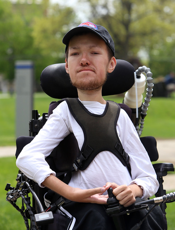 . UMass Lowell graduating senior and math major  Nicholas Raymond, 22, of Chelmsford, who has spinal muscular atrophy, at UML South Campus. (SUN/Julia Malakie)