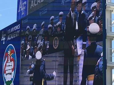 Each graduate shakes the president's hand.