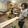 Culinary, woodworking and child care ares at UTEC, which is now in its 20th year. Alex Santana, 19, of Lowell, feeds cutting board planks through the Timesaver sander. (SUN/Julia Malakie)