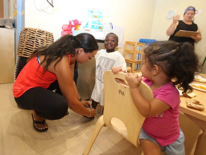 Culinary, woodworking and child care ares at UTEC, which is now in its 20th year. Lead toddler teacher Renee Hall of Pelham, N.H., left wtih Elijah Gaston, 2, of Lowell, Nayalee Andino, 2, of Lowell, and lead toddler teacher Jess Ondras of Lowell, rear, at the 2Gen Early Childhood Center (SUN/Julia Malakie)