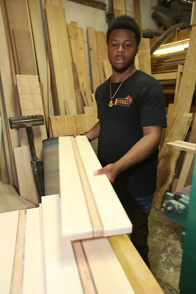 Culinary, woodworking and child care areas at UTEC, which is now in its 20th year. Lawrence Camillo, 22, of Lowell, stacks planks for cutting boards as they come out of the Timesaver sanding machine. (SUN/Julia Malakie)