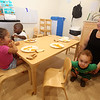 Culinary, woodworking and child care ares at UTEC, which is now in its 20th year. From left, Nayalee Andino, 2, Elijah Gaston, 2, Julian Delima, 1-1/2, and lead toddler teacher Jess Ondras, all of Lowell, at the 2Gen Early Childhood Center. (SUN/Julia Malakie)