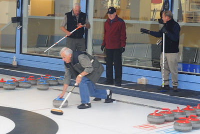 first day curler John Reid getting lots of advise