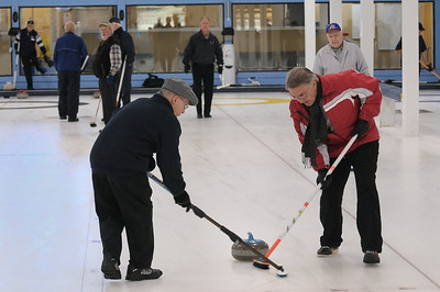 Michael Hernandez and Ted Daem sweeping