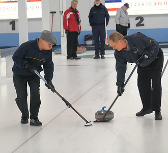 Michael Hernandez and Brian Giroday sweeping