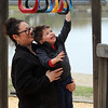 Melissa Martel of Chelmsford helps her son Weston Martel, 2-1/2, on the play structure at Varney Playground in North Chelmsford.  JULIA MALAKIE/LOWELLSUN