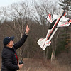 Features at Vietnam Veterans Park in Billerica. Alfredo Galvan of Lexington launches his aerobatic plane after attaching a fresh battery, at the Middlesex County R-C Flying Field. (SUN/Julia Malakie)