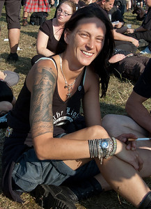 Sabine Weber from Knittelfeld, Austria at Wacken Open Air 2011. Tattoo by Harry Wazek of Tattoo Nation. ( 1 of 2) Outer upper arm: grim reaper, inner upper arm: a beautiful young lady. This signifies that death is only an outer characteristic - life is on the inside.