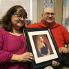 Arnie and Alice Muscovitz of Lowell, who are retiring as leaders of the Merrimack Valley chapter of Parents of Murdered Children due to the declining attendance at meetings and to spend more time enjoying retirement. Their daughter Karen, in photo, was killed in January 2004 in Florida. (SUN/Julia Malakie)