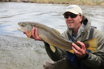 Dedicated Hunter Casey Birkholtz helps with trout population surveys on the Weber River. Photo by Phil Douglass.