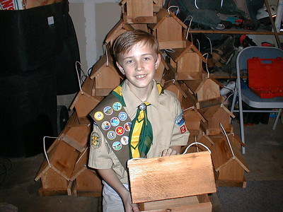 Eagle Scout Tyler Douglass with bird feeders he and his troop made for local nursing homes.