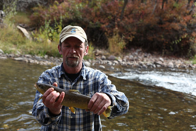 Doug Booth from Weber Basin Anglers, a local chapter of Trout Unlimited helps with fish population surveys on the Ogden River. Photo by Phil Douglass