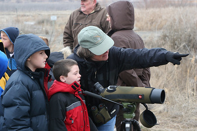Deedee O'Brien helps youngsters enjoy birds.  She serves as a Volunteer Naturalist at the Farmington Bay Nature Center. Photo by Phil Douglass