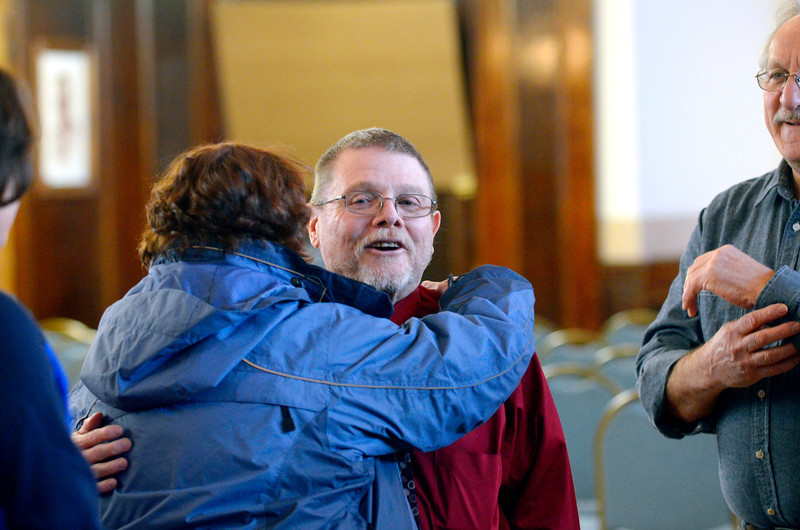 Walter Poirier, who is retiring from his position as the assessor for the city of Leominster, receives a hug from Judith Sumner, Leominster Recreation director, during his retirement party at Leominster City Hall, Thursday.<br /> SENTINEL & ENTERPRISE / BRETT CRAWFORD