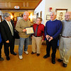 Walter Poirier (3rd from right), who is retiring from his position as the assessor for the city of Leominster, receives a plaque from Leominster City Councilors (from left), Claire Freda, Mark Bodanza, Richard Marchand, Robert Salvatelli, and James Lanciani Jr., during Poirier's retirement party at Leominster City Hall, Thursday.<br /> SENTINEL & ENTERPRISE / BRETT CRAWFORD