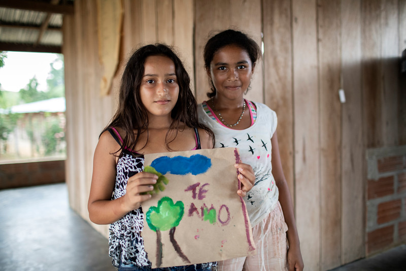 While waiting for the start of the workshops, a young girl has written a message for her mum telling her she loves her.