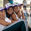 Some young women pose with their new caps that they were given at the start of the event.
