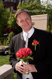 Flowers for me?  How nice... and they match my boutonnière.
