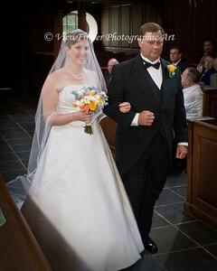 Dad escorts daugher at the Wren Chapel
