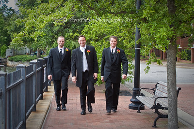 Groom and friends walk to the ceremony