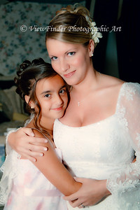 Bride shares a moment with the Flower Girl just before the ceremony.