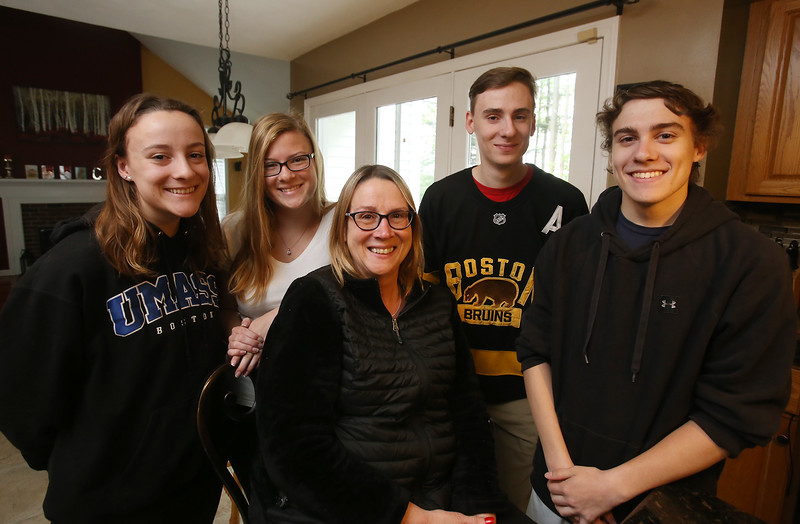 Cornetta quadruplets from Westford are 18, and graduating from high school. Clockwise from left, Kimberly, Jessica, Joe and Dan, with their mother Joanne Cornetta.  (SUN/Julia Malakie)