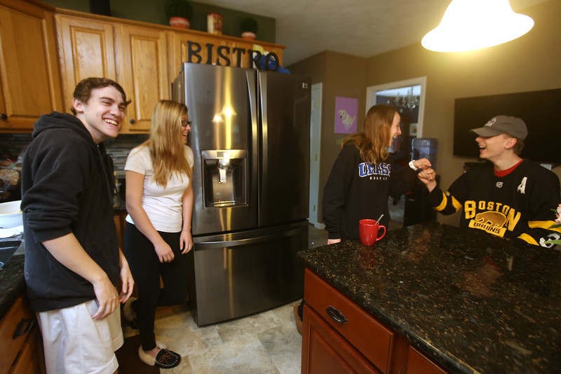 Cornetta quadruplets from Westford are 18, and graduating from high school. From left, Dan, Jessica, Kimberly and Joe.  (SUN/Julia Malakie)